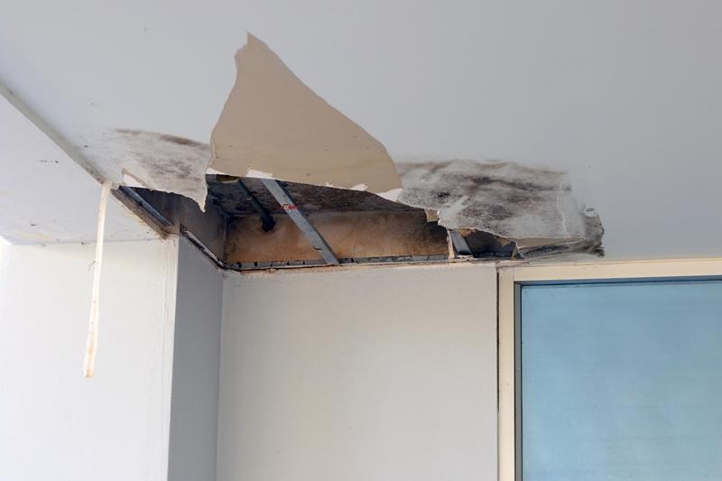 Fix leaky roof Surrey